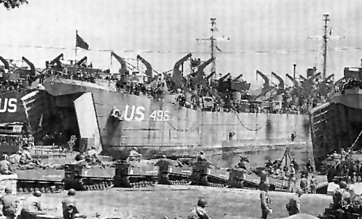 LST-496 disgorging its load on to the Normandy beaches, 1944.