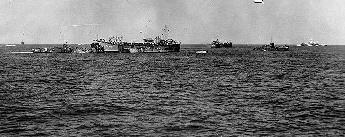 USS LST-499 and other landing craft off Utah Beach, 6 June, 1944.
